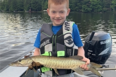 Camden Chart, age 7, New Berlin, WI, 25-incher (first musky), Otter Lake, WI.