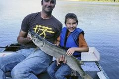 Ivan Griggs, Winchester, KY, 35-incher (first musky), Cave Run Lake, KY. He's seen with his father, Adam.