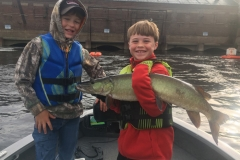 Max Martin, Junction City, WI, 35-incher (first musky), Wisconsin River, WI. He's pictured with his brother, Jack.