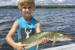 Nate Morrison, age 7, of Markham, ON, with his first musky from Pigeon Lake, ON.