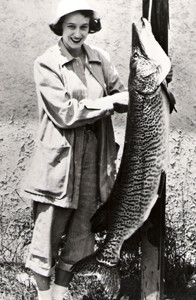 Dolores Lapp with her 56-inch, 50-pound 4-ounce world record tiger musky in 1951.